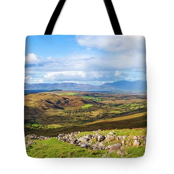 Tote Bag featuring the photograph Panorama Of A Colourful Undulating Irish Landscape In Kerry by Semmick Photo