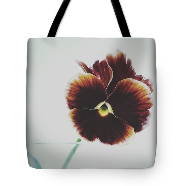 Tote Bag featuring the photograph Pansy Face by Karen Stahlros