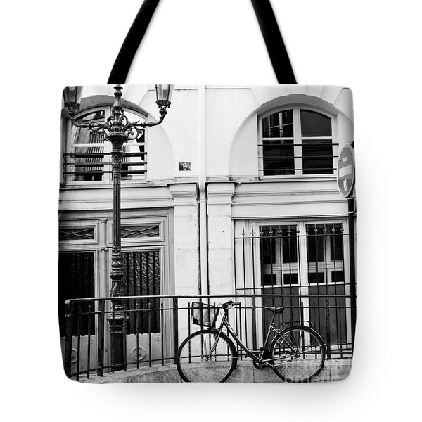 Tote Bag featuring the photograph Paris Black And White Architecture Windows Street Lanterns Bicycle Print - Paris Street Lanterns by Kathy Fornal