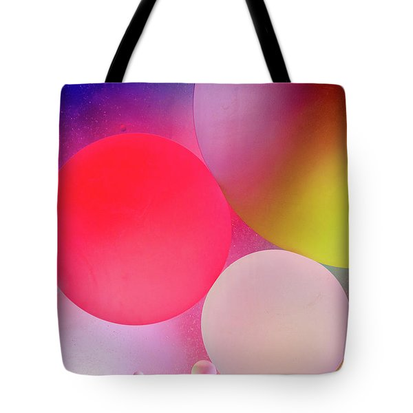 Tote Bag featuring the photograph Pastel Oil Bubble Water Drops by John Williams