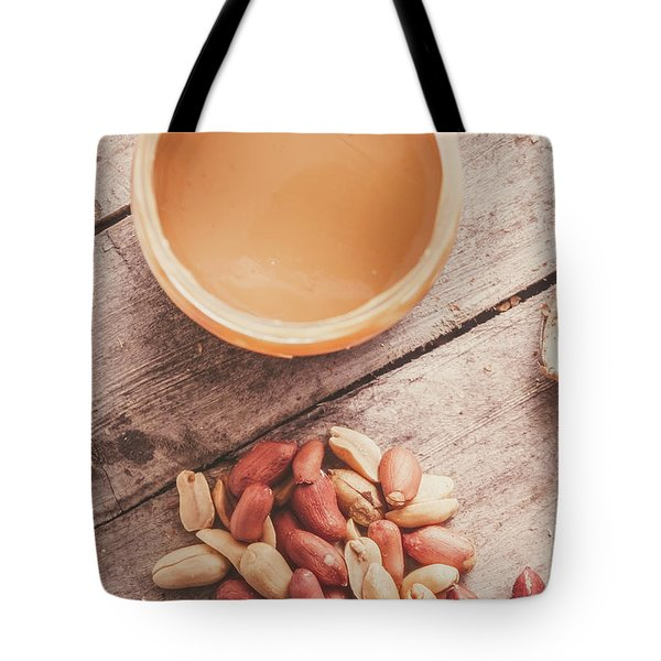 Peanut Butter Jar With Peanuts On Wooden Surface Tote Bag