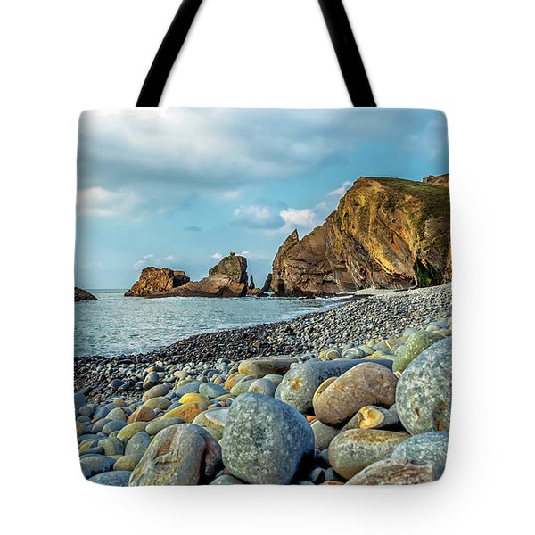 Tote Bag featuring the photograph Pebbles On The Beach by Nick Bywater