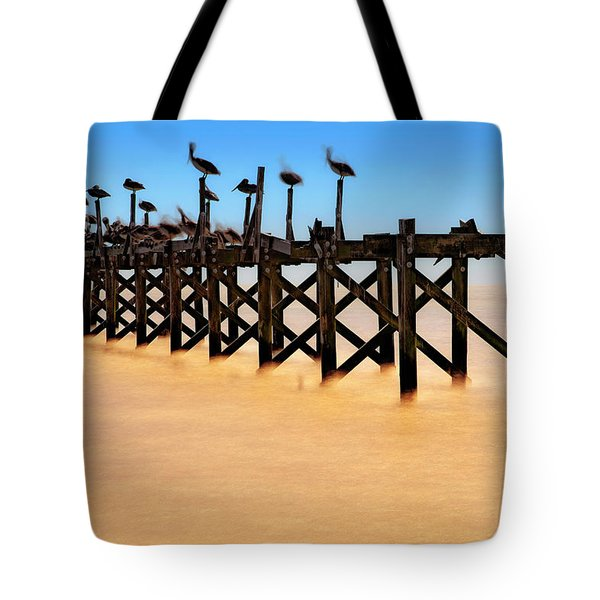 Tote Bag featuring the photograph Pelican Pier Near Pass Christian - Mississippi by Jason Politte