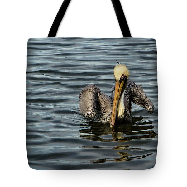 Tote Bag featuring the photograph Pelican Wing In A  Twist by Jean Noren