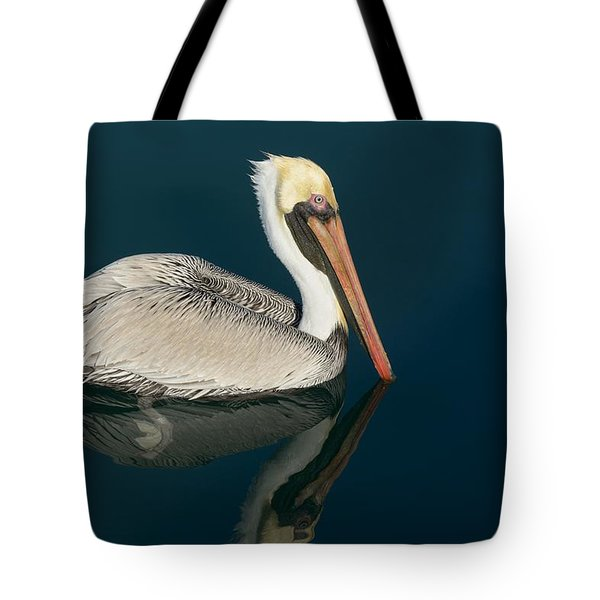 Tote Bag featuring the photograph Pelican With Reflection by Bradford Martin