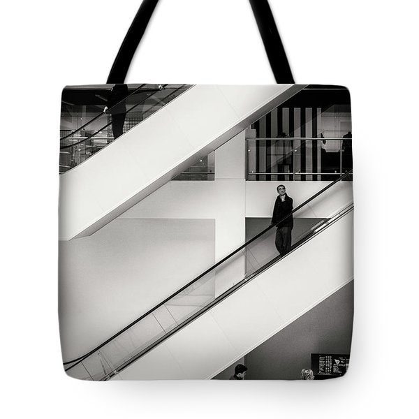 Tote Bag featuring the photograph People Divided by John Williams
