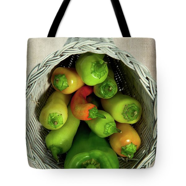 Tote Bag featuring the photograph Peppers In A Horn Of Plenty Basket by Dan Carmichael