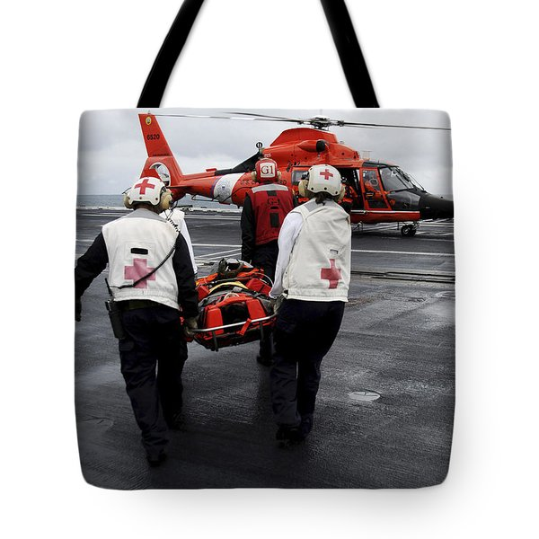 Personnel Carry An Injured Sailor Tote Bag by Stocktrek Images