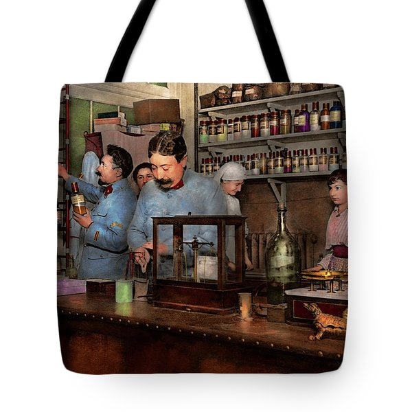 Tote Bag featuring the photograph Pharmacy - The Dispensing Chemist 1918 by Mike Savad