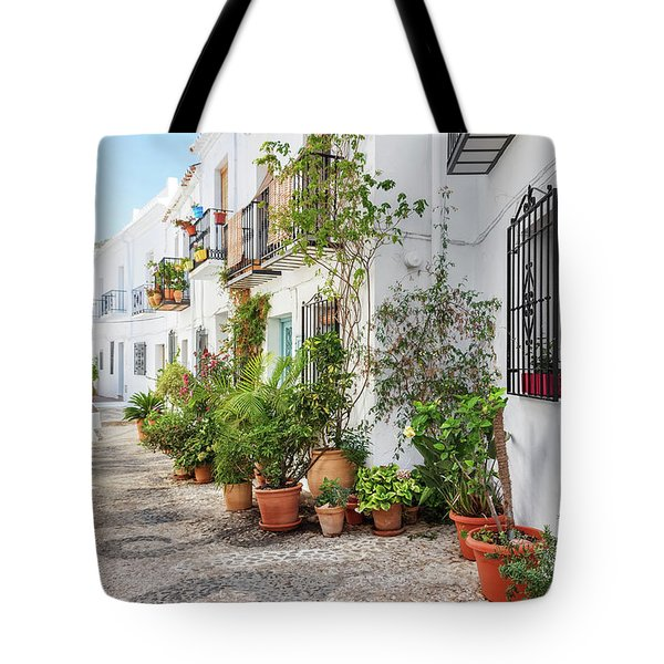 Picturesque Narrow Street Decorated With Plants Tote Bag