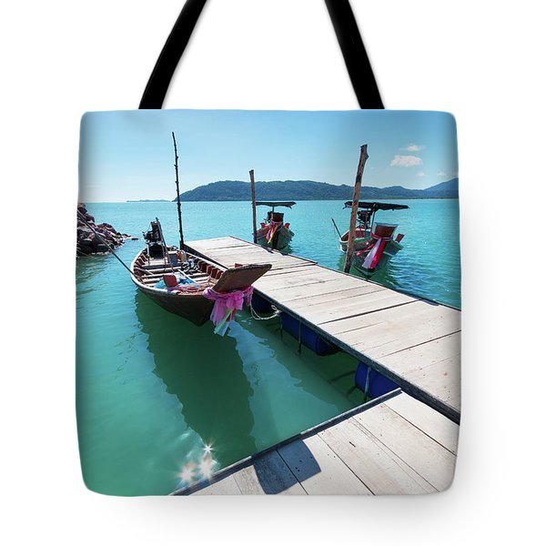 Tote Bag featuring the photograph Pier At Khanom by Atiketta Sangasaeng