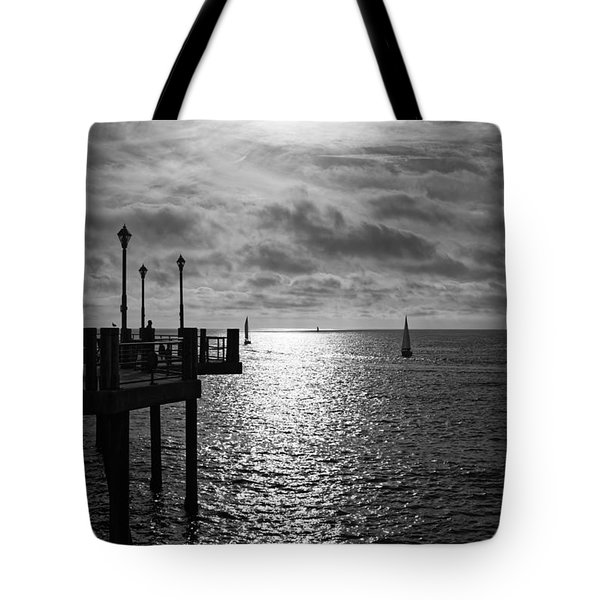Tote Bag featuring the photograph Pier Into The Sun by Michael Hope