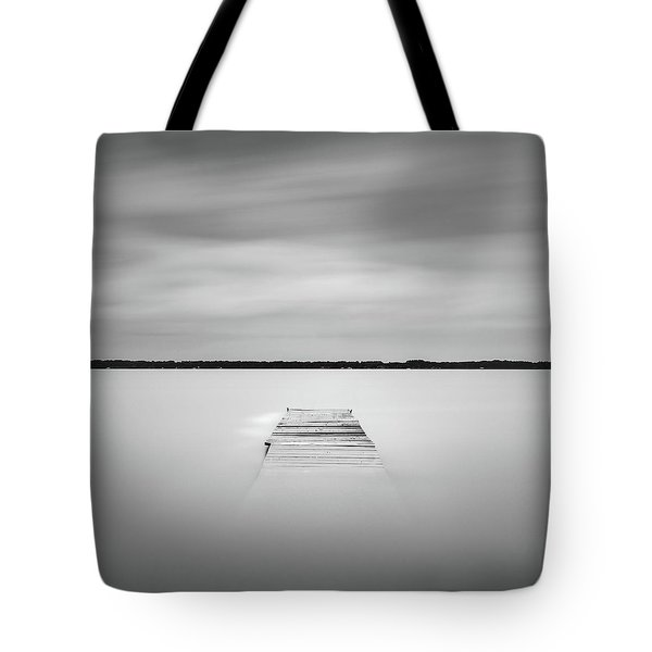 Tote Bag featuring the photograph Pier Sinking Into The Water by Todd Aaron