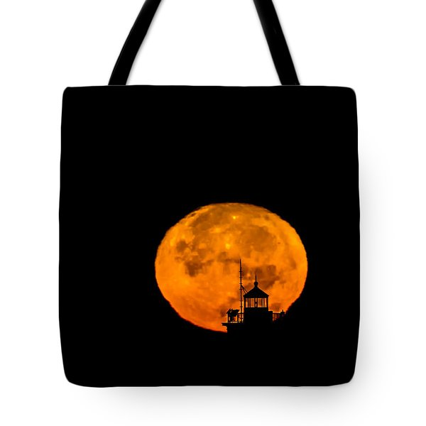 Tote Bag featuring the photograph Pierhead Supermoon Silhouette by Everet Regal