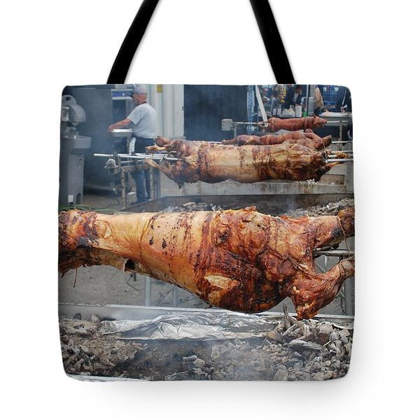 Tote Bag featuring the photograph Pig Roast by Bill Thomson
