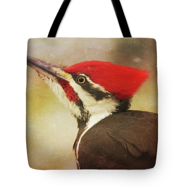 Tote Bag featuring the photograph Pileated Woodpecker With Snowfall by Heidi Hermes