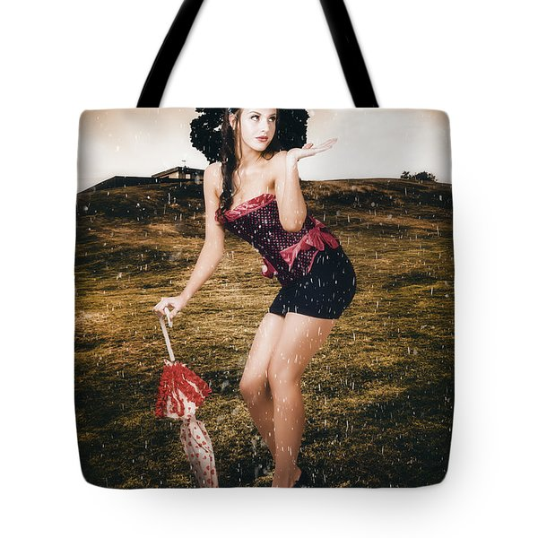 Pin Up Girl Standing In Field Under Summer Rain Tote Bag