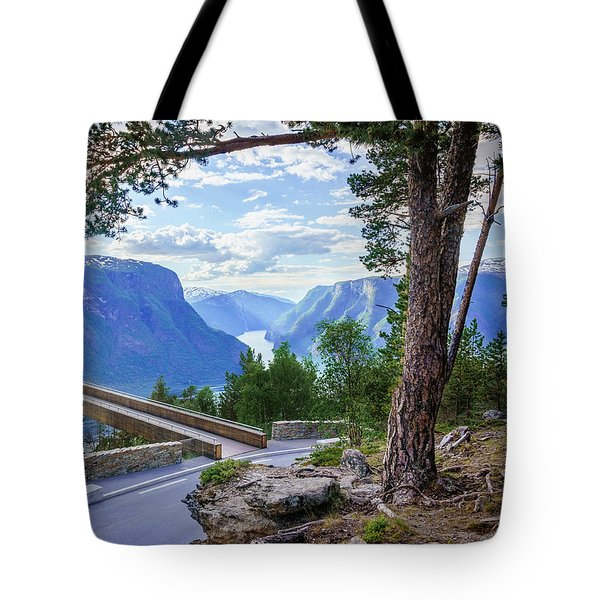 Tote Bag featuring the photograph Pine On Stegastein by Dmytro Korol