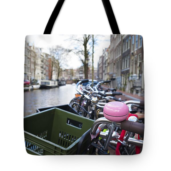 Tote Bag featuring the photograph Pink Bicycle Bell by Hans Engbers