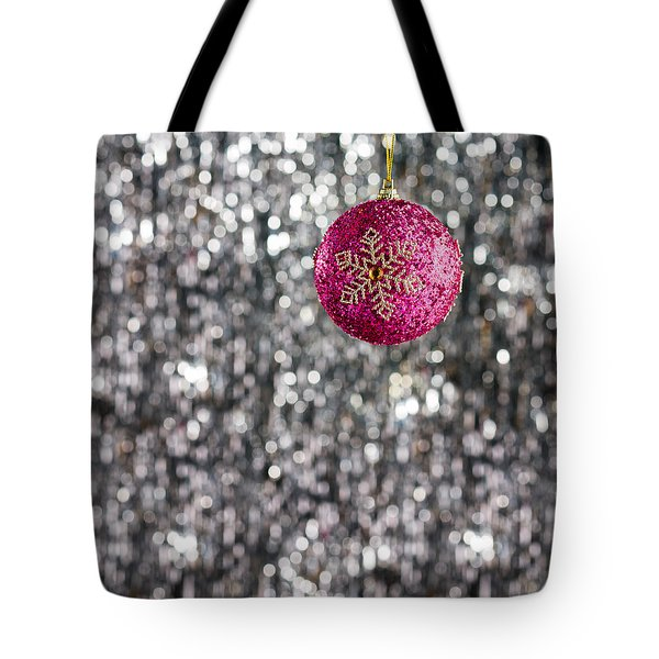 Tote Bag featuring the photograph Pink Christmas Bauble by Ulrich Schade
