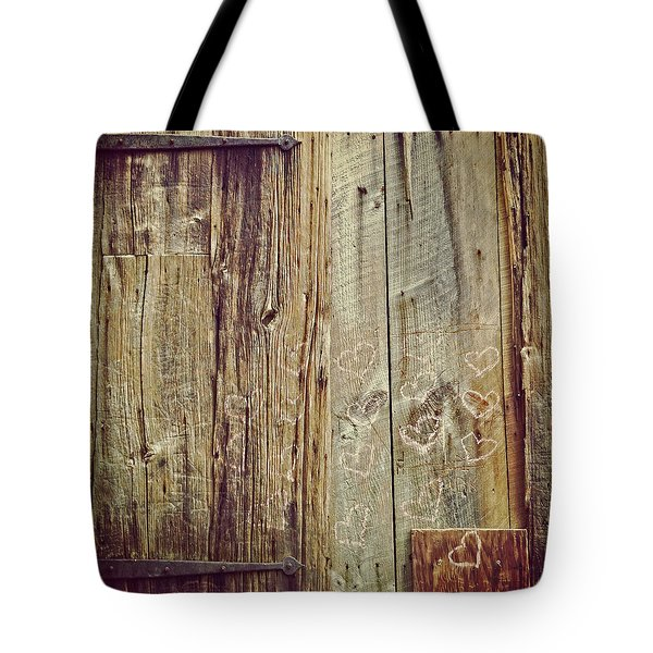 Tote Bag featuring the photograph Pink Hearts On Antique Wood Door by Brooke T Ryan