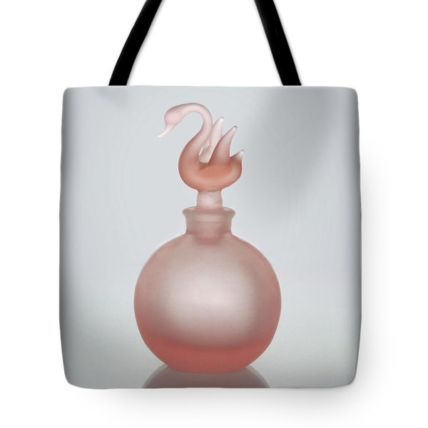 Tote Bag featuring the photograph Pink Perfume Bottle Vertical by David and Carol Kelly