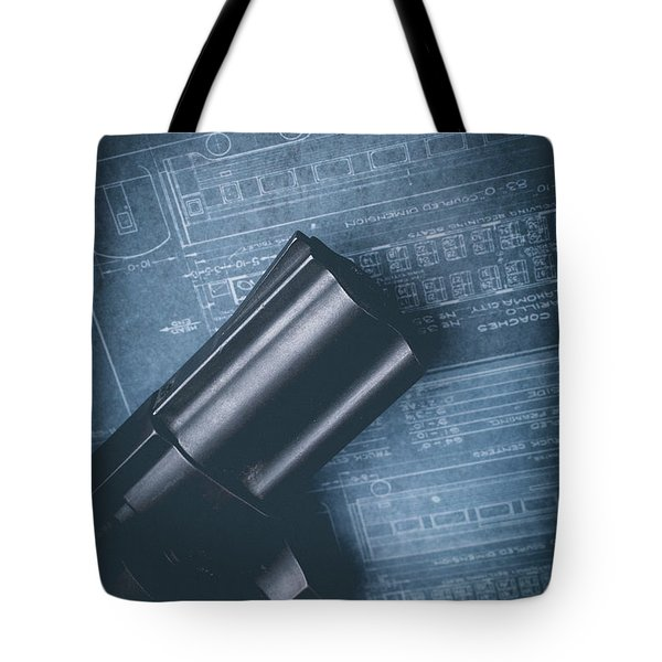Tote Bag featuring the photograph Planning The Heist by Edward Fielding