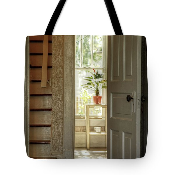 Tote Bag featuring the photograph Plant In Window by Charles McKelroy