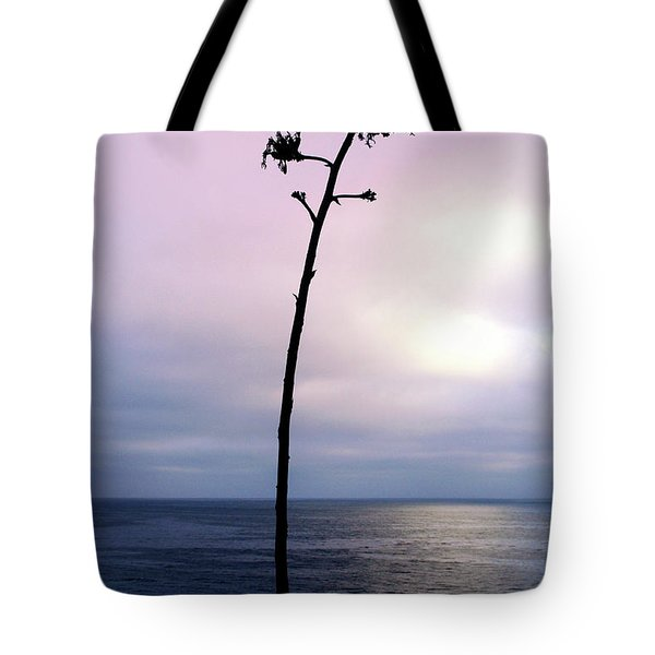 Tote Bag featuring the photograph Plant Silhouette Over Ocean by Mariola Bitner