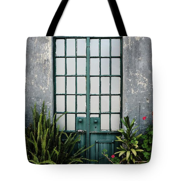 Tote Bag featuring the photograph Plants In The Doorway by Marco Oliveira
