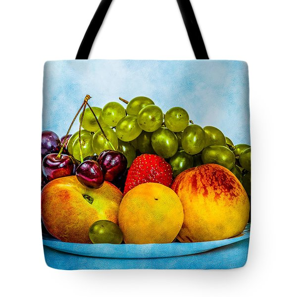 Tote Bag featuring the photograph Plate Of Fresh Fruits by Alexander Senin