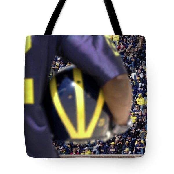 Player Cradling Helmet In Stadium Tote Bag