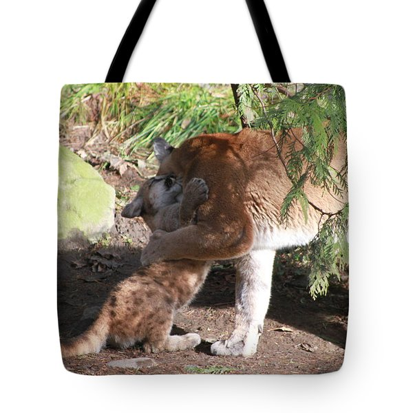 Tote Bag featuring the photograph Playful Hugs by Laddie Halupa