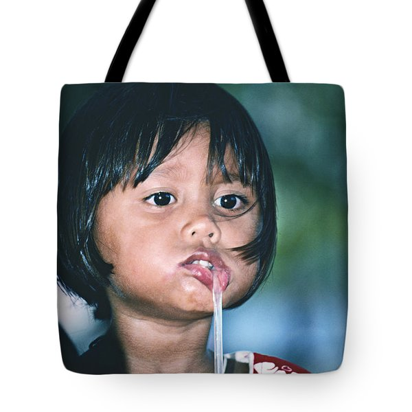 Tote Bag featuring the photograph Playful Little Girl In Thailand by Heiko Koehrer-Wagner