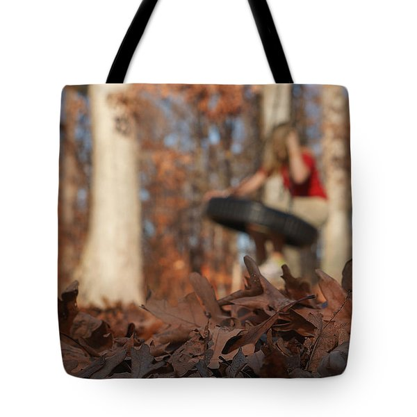 Tote Bag featuring the photograph Playing On The Tire Swing by Greg Collins