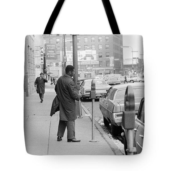 Plugging The Meter Tote Bag