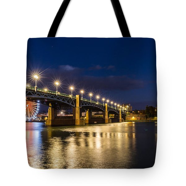 Tote Bag featuring the photograph Pont Saint-pierre With Street Lanterns At Night by Semmick Photo