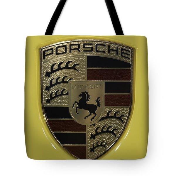 Porsche Emblem On Racing Yellow Tote Bag by Sebastian Musial