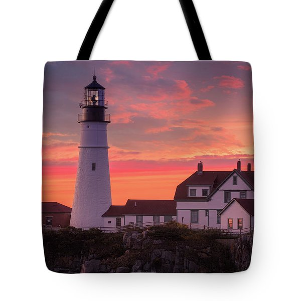 Tote Bag featuring the photograph Portland Head Light Sun Set  by Emmanuel Panagiotakis