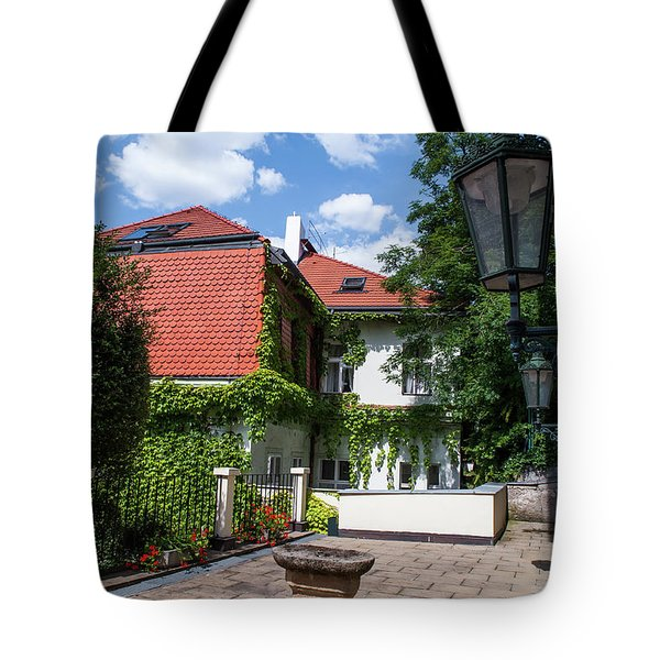 Tote Bag featuring the photograph Prague Courtyards. Old Lantern by Jenny Rainbow
