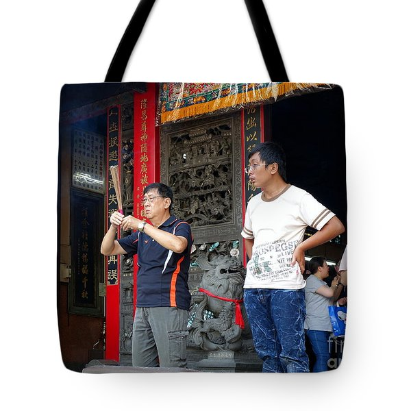 Tote Bag featuring the photograph Praying At A Temple In Taiwan by Yali Shi