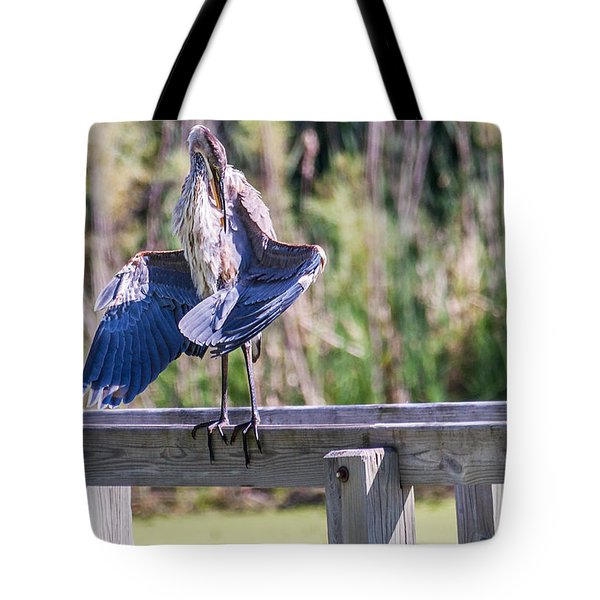 Tote Bag featuring the photograph Preening Gret Blue Heron by Edward Peterson