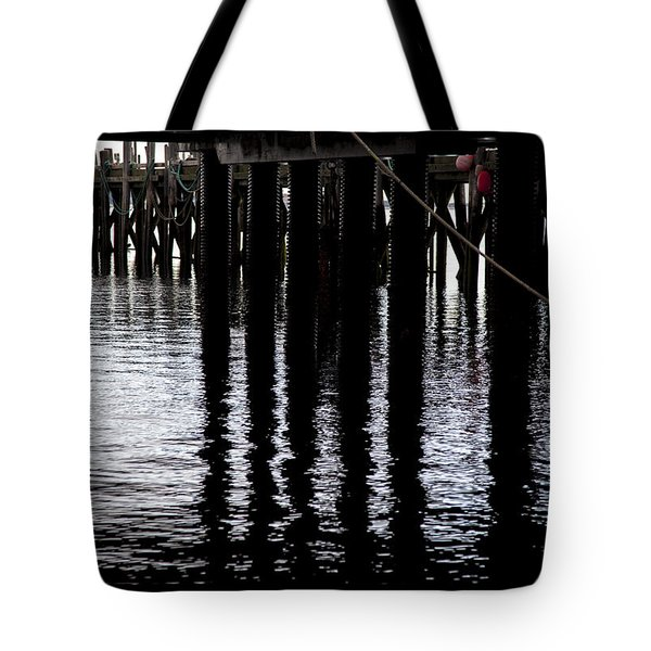 Tote Bag featuring the photograph Provincetown Wharf Reflections by Charles Harden