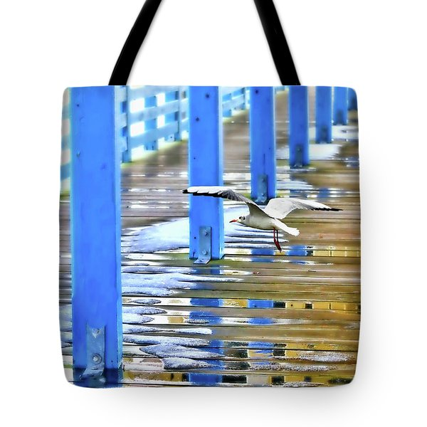 Tote Bag featuring the photograph Puddles by Diana Angstadt