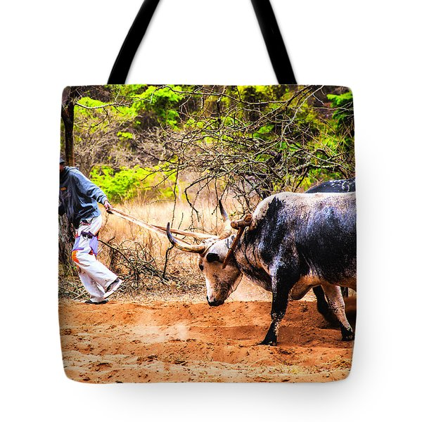 Pulling The Beasts Tote Bag by Rick Bragan