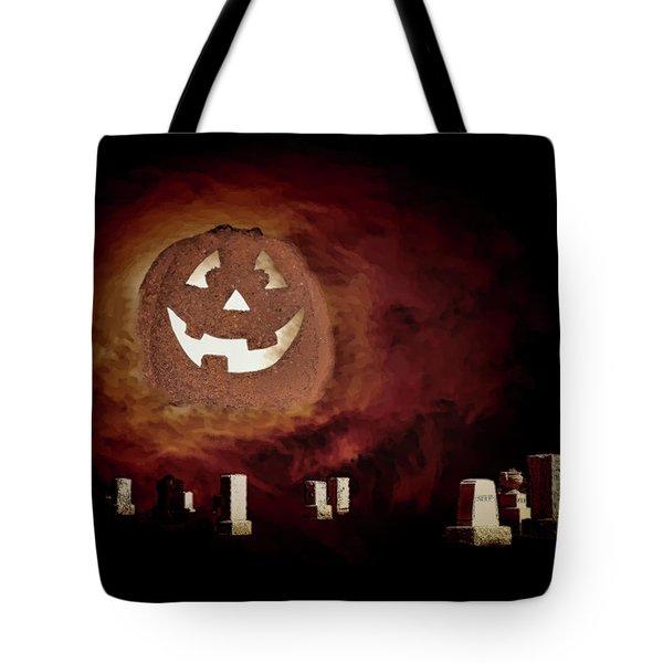 Pumpkin Moon Over Floating Gravestones Tote Bag