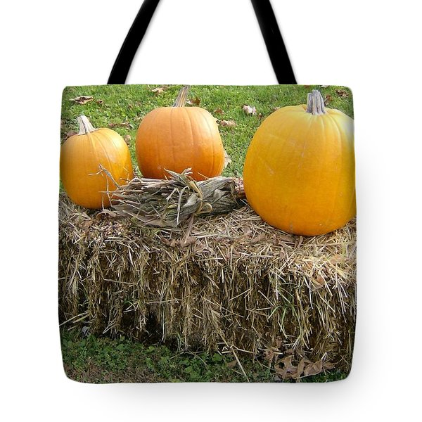 Tote Bag featuring the photograph Pumpkins On A Haystack by Skyler Tipton
