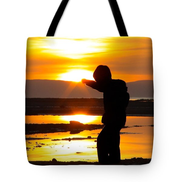 Punching The Sun Tote Bag