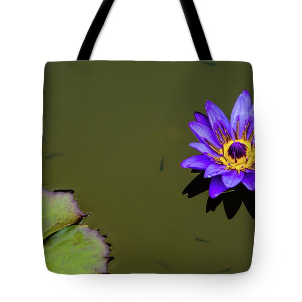 Tote Bag featuring the photograph Purple Lily With Tiny Fish by Dennis Dame