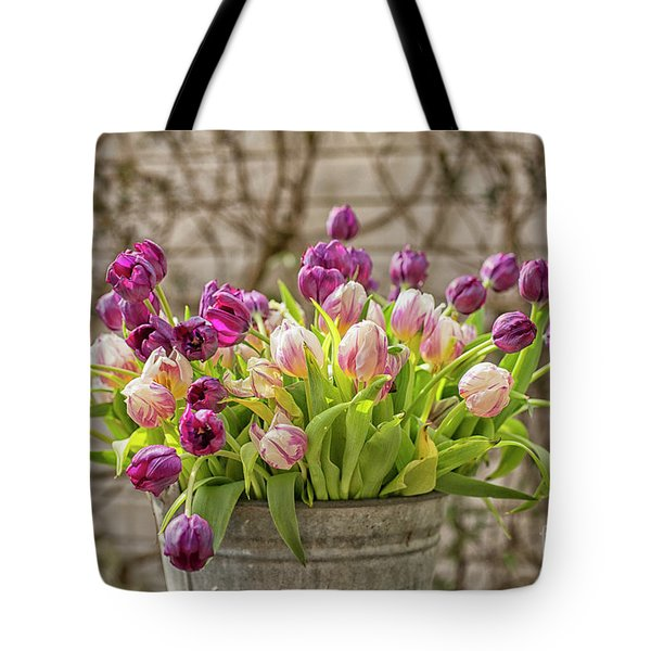 Tote Bag featuring the photograph Purple Tulips In A Bucket by Patricia Hofmeester